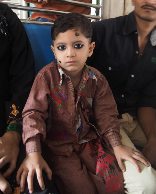 boy on train in Mumbai